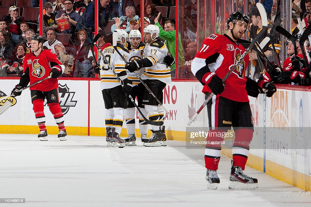 <a gi-track='captionPersonalityLinkClicked' href=/galleries/search?phrase=Milan+Lucic&family=editorial&specificpeople=537957 ng-click='$event.stopPropagation()'>Milan Lucic</a> #17 of the Boston Bruins celebrate his third period goal with teammates <a gi-track='captionPersonalityLinkClicked' href=/galleries/search?phrase=Tyler+Seguin&family=editorial&specificpeople=6698848 ng-click='$event.stopPropagation()'>Tyler Seguin</a> #19 and <a gi-track='captionPersonalityLinkClicked' href=/galleries/search?phrase=David+Krejci&family=editorial&specificpeople=722556 ng-click='$event.stopPropagation()'>David Krejci</a> #46 as Chris Neil #25 and <a gi-track='captionPersonalityLinkClicked' href=/galleries/search?phrase=Nick+Foligno&family=editorial&specificpeople=537821 ng-click='$event.stopPropagation()'>Nick Foligno</a> #71 of the Ottawa Senators skate away at Scotiabank Place on April 5, 2012 in Ottawa, Ontario, Canada.