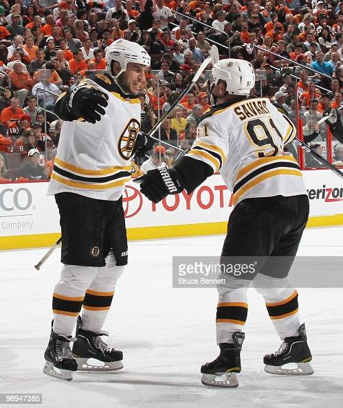 Milan Lucic of the Boston Bruins celebrates a goal with Marc Savard against the Philadelphia Flyers in Game Four of the Eastern Conference Semifinals...