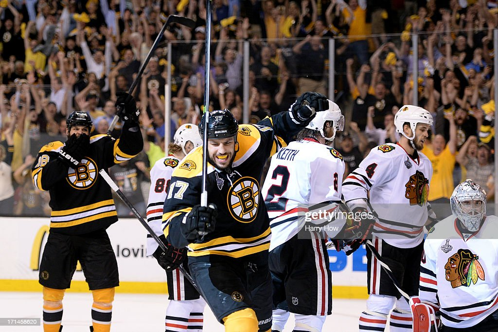 Milan Lucic of the Boston Bruins celebrates after scoing a goal in the third period against Corey Crawford of the Chicago Blackhawks in Game Six of...