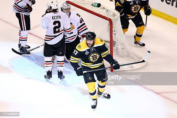 Milan Lucic of the Boston Bruins celebrates after scoring a goal in the third period against Corey Crawford of the Chicago Blackhawks in Game Six of...