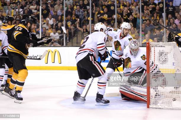 Milan Lucic of the Boston Bruins celebrates as he scores a goal in the third period against Corey Crawford of the Chicago Blackhawks in Game Six of...