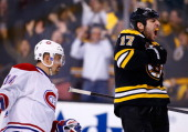Milan Lucic of the Boston Bruins celebrates his emptynet goal in the third period against the Montreal Canadiens in Game Two of the Second Round of...