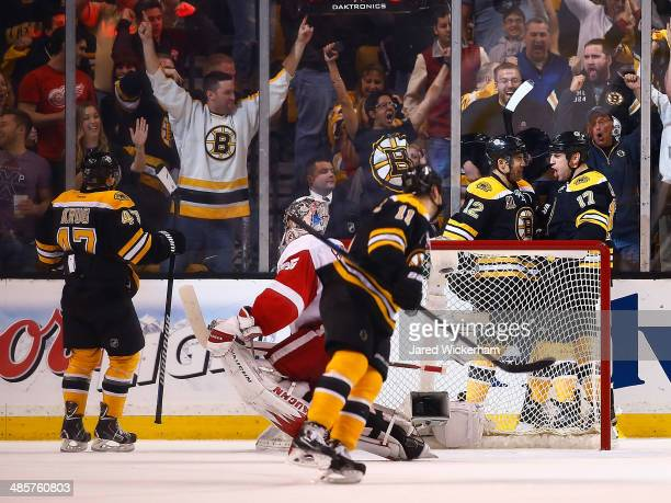 Milan Lucic of the Boston Bruins celebrates his goal with teammate Jarome Iginla behind the net in the second period against the Detroit Red Wings...
