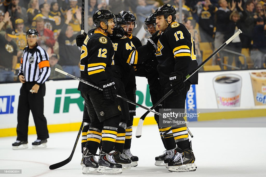<a gi-track='captionPersonalityLinkClicked' href=/galleries/search?phrase=Milan+Lucic&family=editorial&specificpeople=537957 ng-click='$event.stopPropagation()'>Milan Lucic</a> #17 of the Boston Bruins celebrates his goal with teammates against the Detroit Red Wings at the TD Garden on October 14, 2013 in Boston, Massachusetts.