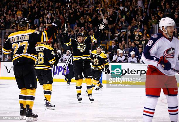 Milan Lucic of the Boston Bruins celebrates his second goal of the game in the third period against the Columbus Blue Jackets during the game at TD...