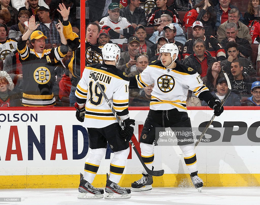 <a gi-track='captionPersonalityLinkClicked' href=/galleries/search?phrase=Milan+Lucic&family=editorial&specificpeople=537957 ng-click='$event.stopPropagation()'>Milan Lucic</a> #17 of the Boston Bruins celebrates his third period goal with teammate <a gi-track='captionPersonalityLinkClicked' href=/galleries/search?phrase=Tyler+Seguin&family=editorial&specificpeople=6698848 ng-click='$event.stopPropagation()'>Tyler Seguin</a> #19 during an NHL game against the Ottawa Senators at Scotiabank Place on April 5, 2012 in Ottawa, Ontario, Canada.