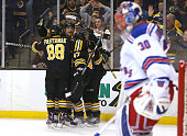 Milan Lucic of the Boston Bruins celebrates hits second goal against Henrik Lundqvist of the New York Rangers in the first period at the TD Garden on...