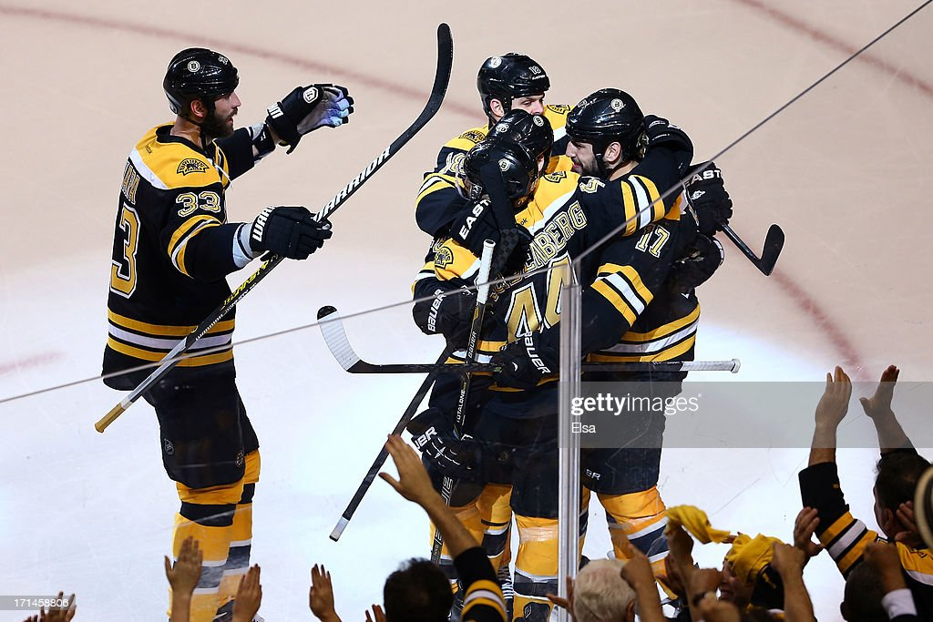 Milan Lucic of the Boston Bruins celebrates with his teammates Nathan Horton David Krejci Dennis Seidenberg and Zdeno Chara after scoring a goal in...