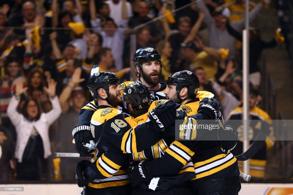 <a gi-track='captionPersonalityLinkClicked' href=/galleries/search?phrase=Milan+Lucic&family=editorial&specificpeople=537957 ng-click='$event.stopPropagation()'>Milan Lucic</a> #17 of the Boston Bruins celebrates with <a gi-track='captionPersonalityLinkClicked' href=/galleries/search?phrase=Nathan+Horton&family=editorial&specificpeople=204741 ng-click='$event.stopPropagation()'>Nathan Horton</a> #18, Zdeno Chara #33 and <a gi-track='captionPersonalityLinkClicked' href=/galleries/search?phrase=Dennis+Seidenberg&family=editorial&specificpeople=204616 ng-click='$event.stopPropagation()'>Dennis Seidenberg</a> #44 after scoring a goal in the second period against the Chicago Blackhawks in Game Four of the 2013 NHL Stanley Cup Final at TD Garden on June 19, 2013 in Boston, Massachusetts.