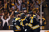 Milan Lucic of the Boston Bruins celebrates with Nathan Horton Zdeno Chara and Dennis Seidenberg after scoring a goal in the second period against...