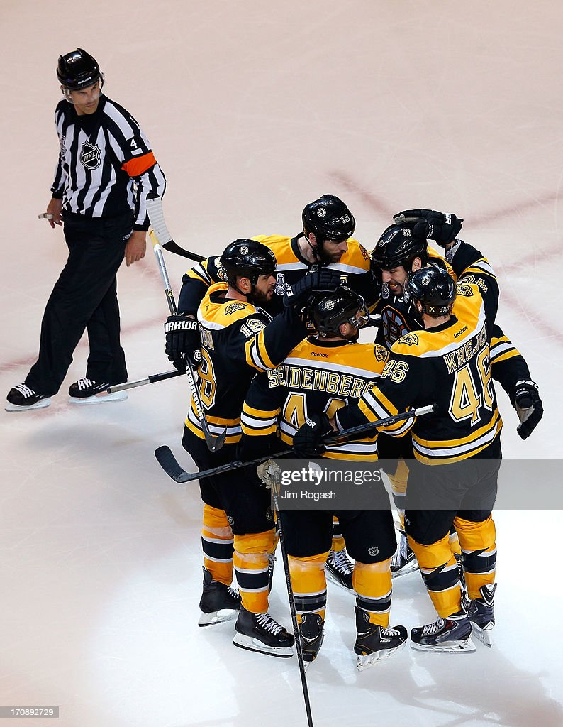 Milan Lucic #17 of the Boston Bruins celebrates with Nathan Horton #18, Zdeno Chara #33, Dennis Seidenberg #44 and David Krejci #46 after a goal against the Chicago Blackhawks in Game Four of the 2013 NHL Stanley Cup Final at TD Garden on June 19, 2013 in Boston, Massachusetts.