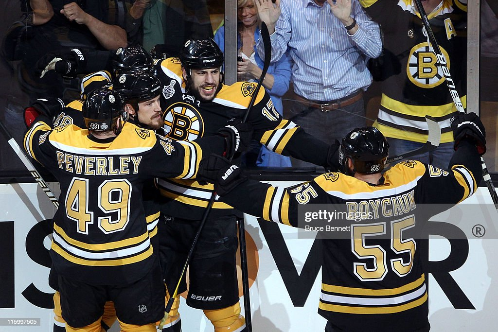 Milan Lucic of the Boston Bruins celebrates with Rich Peverley David Krejci and Johnny Boychuk after scoring a goal in the first period against...