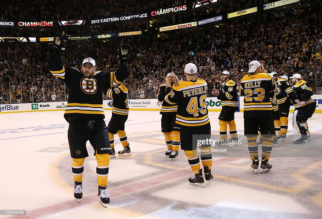 Milan Lucic #17 of the Boston Bruins celebrates with teammates after defeating the Pittsburgh Penguins 1-0 in Game Four of the Eastern Conference Final during the 2013 NHL Stanley Cup Playoffs at the TD Garden on June 7, 2013 in Boston, United States.