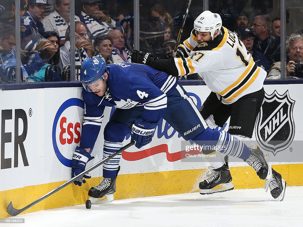 <a gi-track='captionPersonalityLinkClicked' href=/galleries/search?phrase=Milan+Lucic&family=editorial&specificpeople=537957 ng-click='$event.stopPropagation()'>Milan Lucic</a> #17 of the Boston Bruins checks <a gi-track='captionPersonalityLinkClicked' href=/galleries/search?phrase=Cody+Franson&family=editorial&specificpeople=2125769 ng-click='$event.stopPropagation()'>Cody Franson</a> #4 of the Toronto Maple Leafs in Game Three of the Eastern Conference Quarterfinals during the 2013 Stanley Cup Playoffs on May 6, 2013 at the Air Canada Centre in Toronto, Ontario, Canada. The Bruins defeated the Leafs 5-2 to take a 2-1 series lead.