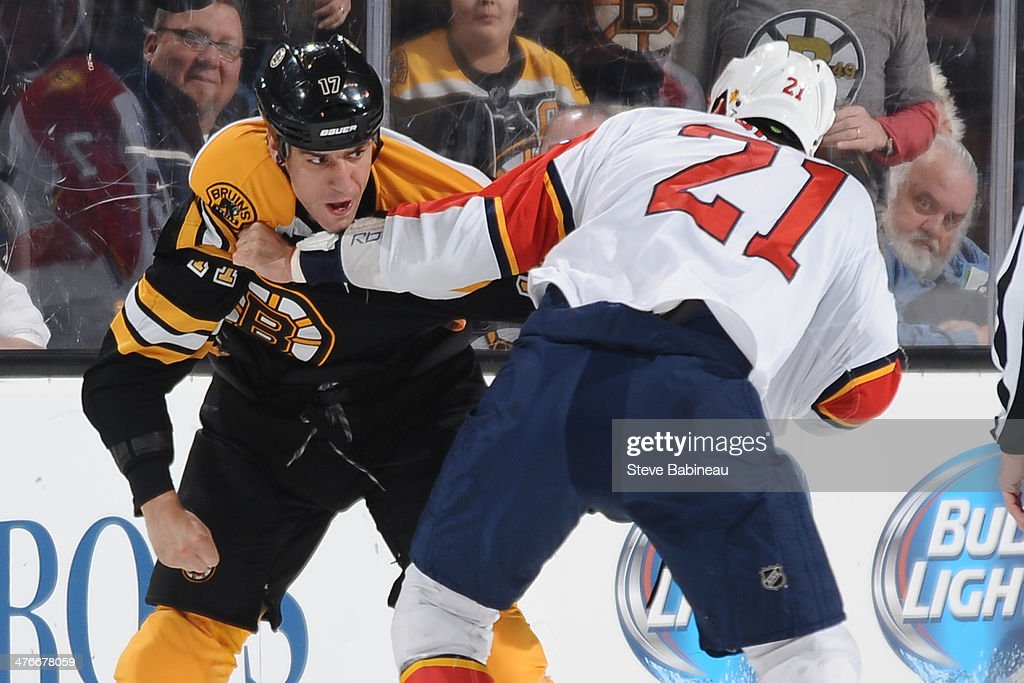 Milan Lucic of the Boston Bruins fights against Krys Barch of the Florida Panthers at the TD Garden on March 4 2014 in Boston Massachusetts