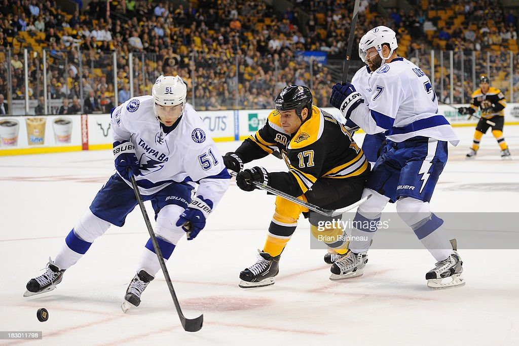 <a gi-track='captionPersonalityLinkClicked' href=/galleries/search?phrase=Milan+Lucic&family=editorial&specificpeople=537957 ng-click='$event.stopPropagation()'>Milan Lucic</a> #17 of the Boston Bruins fights for the puck against Valtteri Filuppa #51 and <a gi-track='captionPersonalityLinkClicked' href=/galleries/search?phrase=Radko+Gudas&family=editorial&specificpeople=5648763 ng-click='$event.stopPropagation()'>Radko Gudas</a> #7 of the Tampa Bay Lightning at the TD Garden on October 3, 2013 in Boston, Massachusetts.