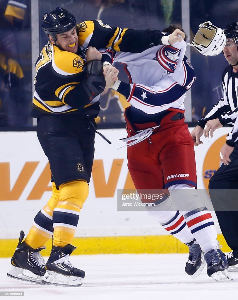 <a gi-track='captionPersonalityLinkClicked' href=/galleries/search?phrase=Milan+Lucic&family=editorial&specificpeople=537957 ng-click='$event.stopPropagation()'>Milan Lucic</a> #17 of the Boston Bruins fights with <a gi-track='captionPersonalityLinkClicked' href=/galleries/search?phrase=Dalton+Prout&family=editorial&specificpeople=6263673 ng-click='$event.stopPropagation()'>Dalton Prout</a> #47 of the Columbus Blue Jackets in the second period during the game at TD Garden on November 30, 2013 in Boston, Massachusetts.