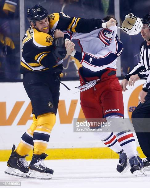 Milan Lucic of the Boston Bruins fights with Dalton Prout of the Columbus Blue Jackets in the second period during the game at TD Garden on November...