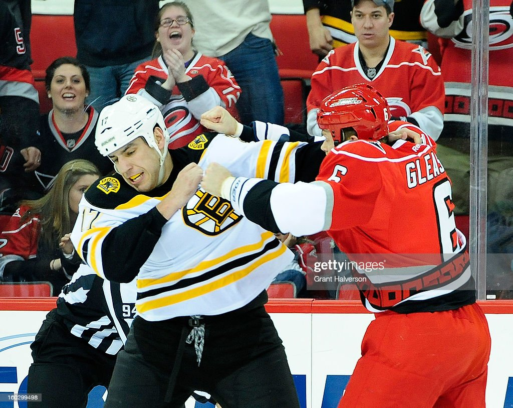 <a gi-track='captionPersonalityLinkClicked' href=/galleries/search?phrase=Milan+Lucic&family=editorial&specificpeople=537957 ng-click='$event.stopPropagation()'>Milan Lucic</a> #17 of the Boston Bruins fights with <a gi-track='captionPersonalityLinkClicked' href=/galleries/search?phrase=Tim+Gleason&family=editorial&specificpeople=211575 ng-click='$event.stopPropagation()'>Tim Gleason</a> #6 of the Carolina Hurricanes during play at PNC Arena on January 28, 2013 in Raleigh, North Carolina.