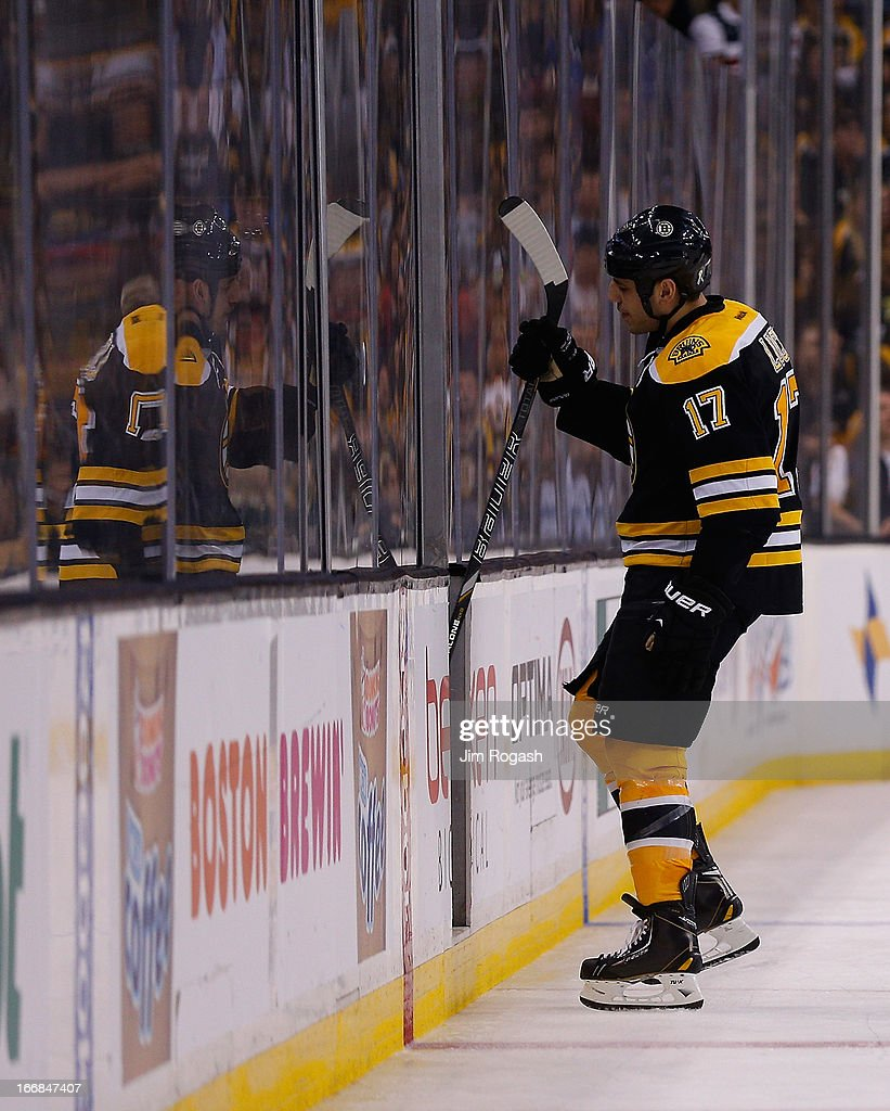 Milan Lucic #17 of the Boston Bruins heads to the penalty box after he was called for high sticking Adam Pardy #27 of the Buffalo Sabres in the third period at TD Garden on April 17, 2013 in Boston, Massachusetts.