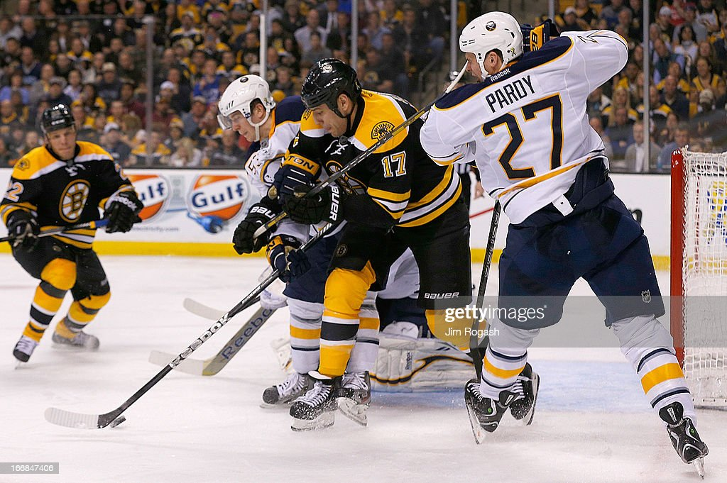 <a gi-track='captionPersonalityLinkClicked' href=/galleries/search?phrase=Milan+Lucic&family=editorial&specificpeople=537957 ng-click='$event.stopPropagation()'>Milan Lucic</a> #17 of the Boston Bruins high sticks <a gi-track='captionPersonalityLinkClicked' href=/galleries/search?phrase=Adam+Pardy&family=editorial&specificpeople=2221762 ng-click='$event.stopPropagation()'>Adam Pardy</a> #27 of the Buffalo Sabres in the third period at TD Garden on April 17, 2013 in Boston, Massachusetts.