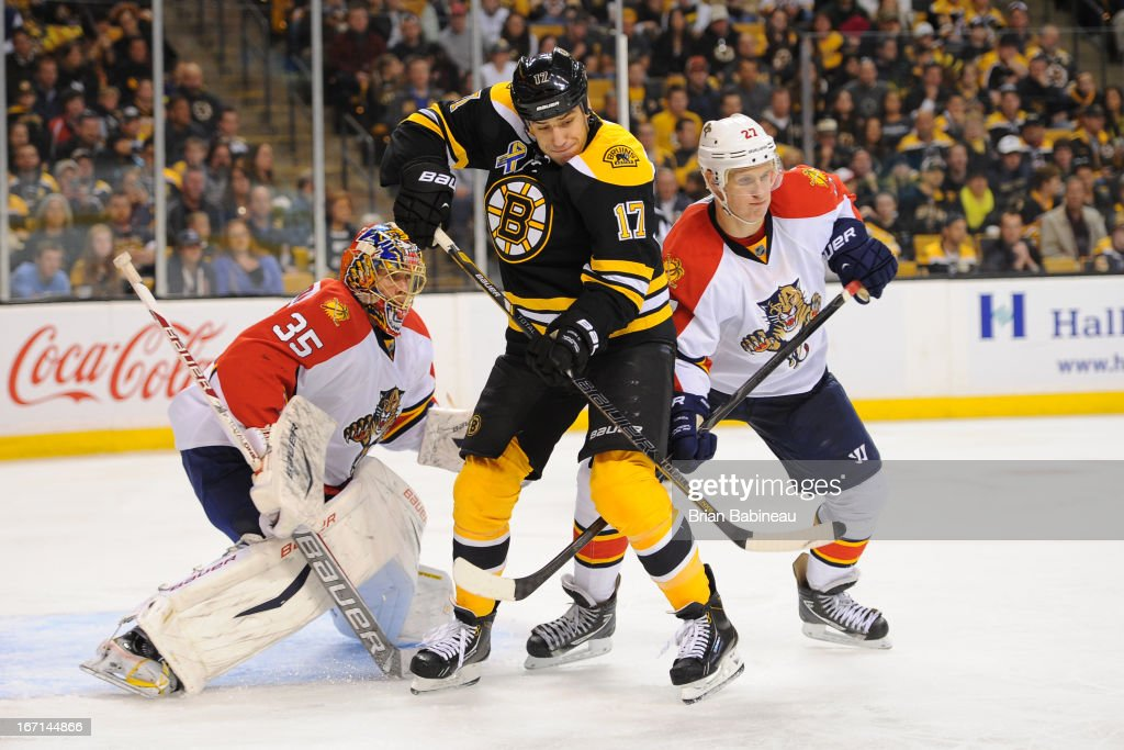<a gi-track='captionPersonalityLinkClicked' href=/galleries/search?phrase=Milan+Lucic&family=editorial&specificpeople=537957 ng-click='$event.stopPropagation()'>Milan Lucic</a> #17 of the Boston Bruins <a gi-track='captionPersonalityLinkClicked' href=/galleries/search?phrase=Jacob+Markstrom&family=editorial&specificpeople=5370948 ng-click='$event.stopPropagation()'>Jacob Markstrom</a> #35 and Nick Bjugsdtad #27 of against the Florida Panthers at the TD Garden on April 21, 2013 in Boston, Massachusetts.