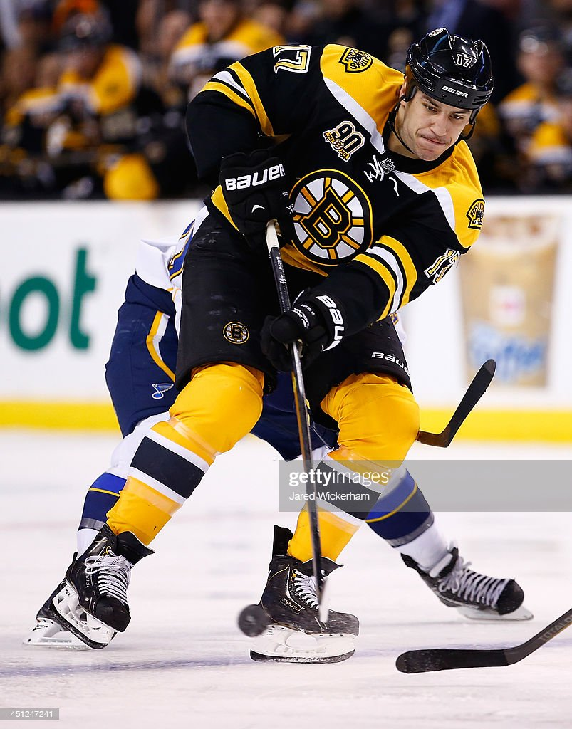 <a gi-track='captionPersonalityLinkClicked' href=/galleries/search?phrase=Milan+Lucic&family=editorial&specificpeople=537957 ng-click='$event.stopPropagation()'>Milan Lucic</a> #17 of the Boston Bruins passes the puck against the St Louis Blues in the third period at TD Garden on November 21, 2013 in Boston, Massachusetts.