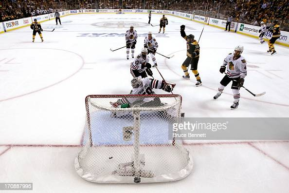 Milan Lucic of the Boston Bruins scores a goal against Corey Crawford of the Chicago Blackhawks during the second period in Game Four of the 2013 NHL...