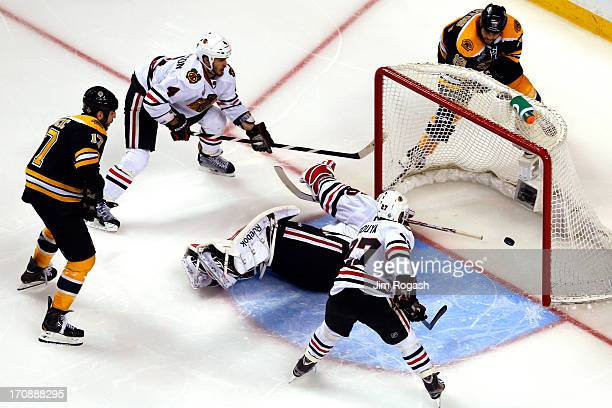 Milan Lucic of the Boston Bruins scores a goal against Corey Crawford of the Chicago Blackhawks in the second period in Game Four of the 2013 NHL...