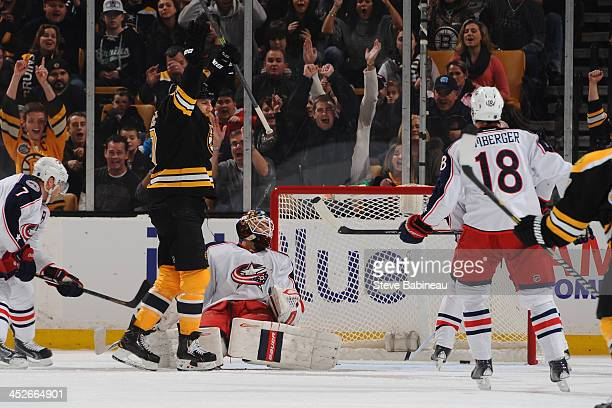Milan Lucic of the Boston Bruins scores a goal against the Columbus Blue Jackets at the TD Garden on November 30 2013 in Boston Massachusetts