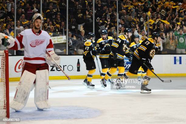Milan Lucic of the Boston Bruins scores a goal against the Detroit Red Wings in Game Five of the First Round of the 2014 Stanley Cup Playoffs at TD...