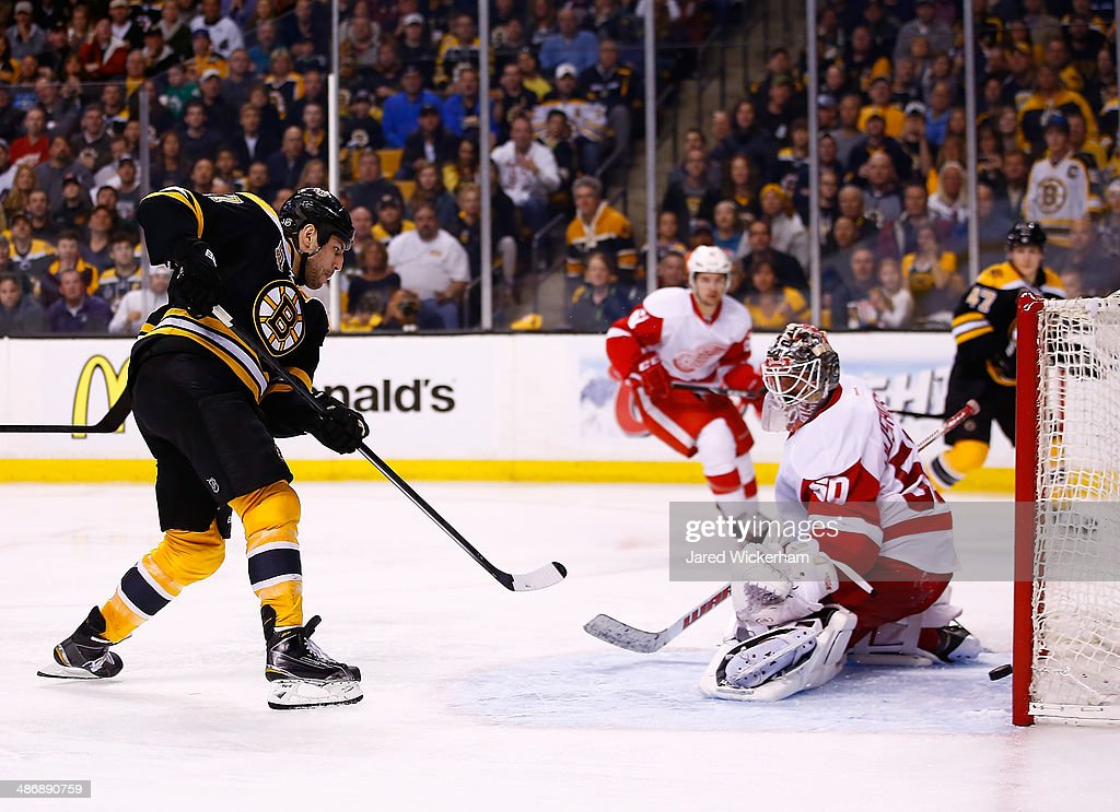 Milan Lucic of the Boston Bruins scores a goal past Jonas Gustavsson of the Detroit Red Wings in the third period in Game Five of the First Round of...