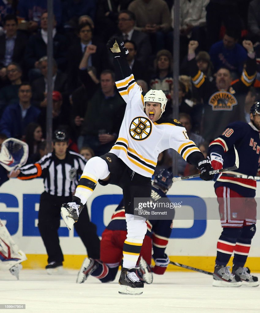 <a gi-track='captionPersonalityLinkClicked' href=/galleries/search?phrase=Milan+Lucic&family=editorial&specificpeople=537957 ng-click='$event.stopPropagation()'>Milan Lucic</a> #17 of the Boston Bruins scores a second period goal against the New York Rangers at Madison Square Garden on January 23, 2013 in New York City.