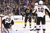 Milan Lucic of the Boston Bruins scores against the Pittsburgh Penguins at the TD Garden on November 24 2014 in Boston Massachusetts