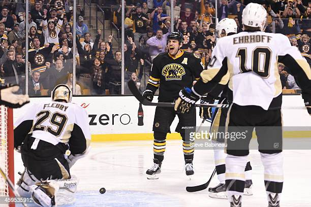 Milan Lucic of the Boston Bruins scores against the Pittsburgh Penguins at the TD Garden on November 24 2014 in Boston Massachusetts
