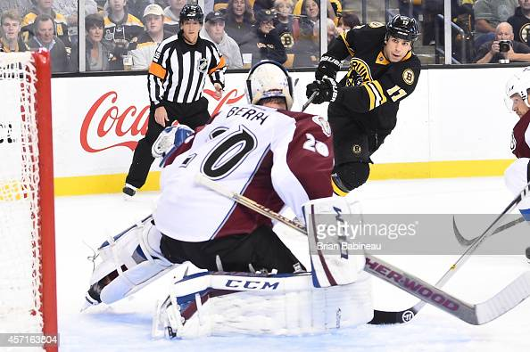 Milan Lucic of the Boston Bruins shoots the puck against Reto Berra of the Colorado Avalanche at the TD Garden on October 13 2014 in Boston...