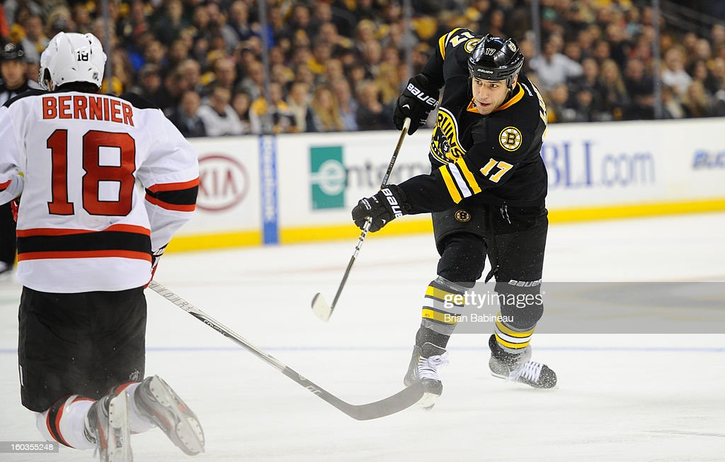 Milan Lucic #17 of the Boston Bruins shoots the puck against the New Jersey Devils at the TD Garden on January 29, 2013 in Boston, Massachusetts.