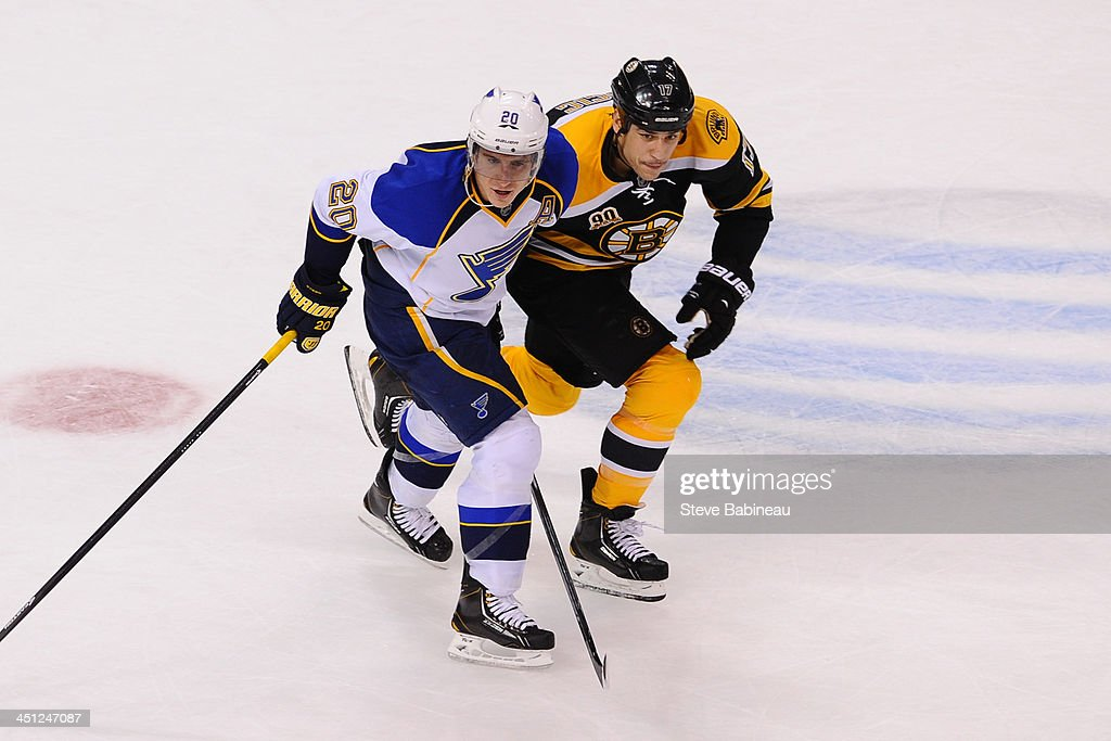 <a gi-track='captionPersonalityLinkClicked' href=/galleries/search?phrase=Milan+Lucic&family=editorial&specificpeople=537957 ng-click='$event.stopPropagation()'>Milan Lucic</a> #17 of the Boston Bruins skates against <a gi-track='captionPersonalityLinkClicked' href=/galleries/search?phrase=Alexander+Steen&family=editorial&specificpeople=600136 ng-click='$event.stopPropagation()'>Alexander Steen</a> #20 of the St. Louis Blues at the TD Garden on November 21, 2013 in Boston, Massachusetts.