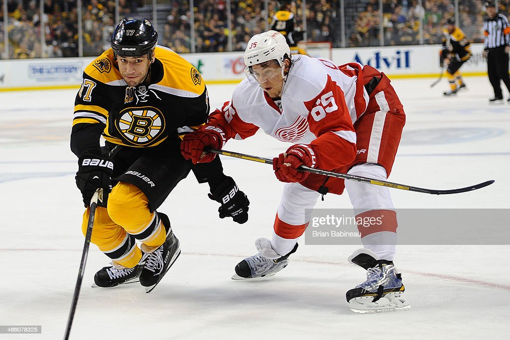 Milan Lucic #17 of the Boston Bruins skates against Danny DeKeyser #65 of the Detroit Red Wings in Game Two of the First Round of the 2014 Stanley Cup Playoffs at TD Garden on April 20, 2014 in Boston, Massachusetts.
