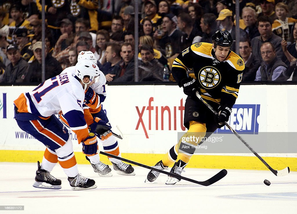 <a gi-track='captionPersonalityLinkClicked' href=/galleries/search?phrase=Milan+Lucic&family=editorial&specificpeople=537957 ng-click='$event.stopPropagation()'>Milan Lucic</a> #17 of the Boston Bruins skates up the ice with the puck as <a gi-track='captionPersonalityLinkClicked' href=/galleries/search?phrase=Frans+Nielsen&family=editorial&specificpeople=634894 ng-click='$event.stopPropagation()'>Frans Nielsen</a> #51 of the New York Islanders defends at the TD Garden on April 11, 2013 in Boston, Massachusetts.
