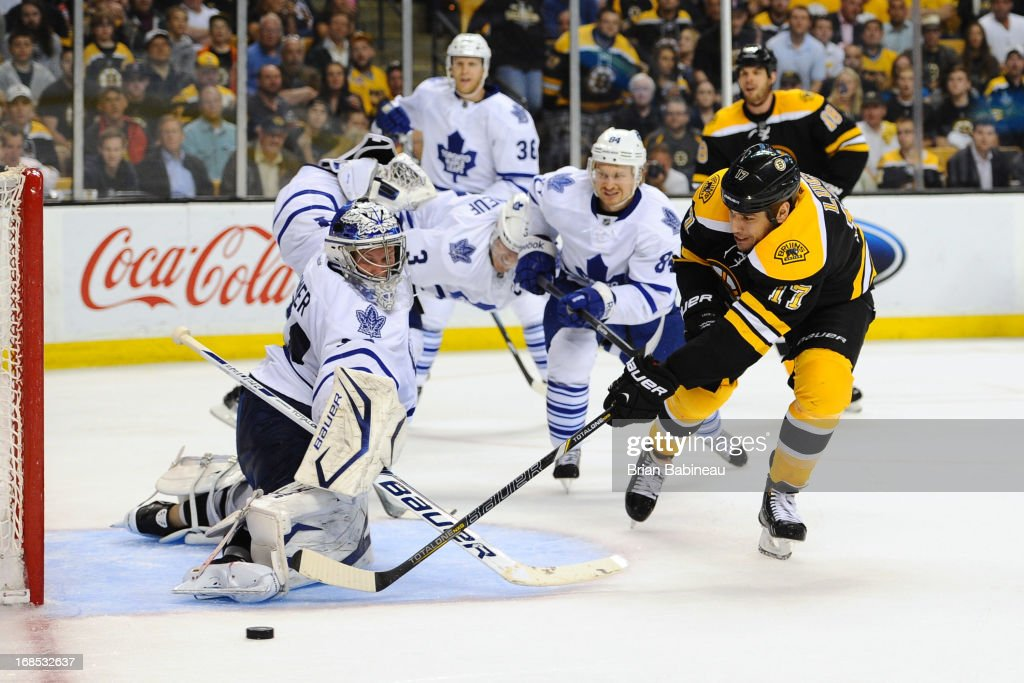<a gi-track='captionPersonalityLinkClicked' href=/galleries/search?phrase=Milan+Lucic&family=editorial&specificpeople=537957 ng-click='$event.stopPropagation()'>Milan Lucic</a> #17 of the Boston Bruins tries to get the puck in the net against James Reimer #34 of the Toronto Maple Leafs in Game Five of the Eastern Conference Quarterfinals during the 2013 NHL Stanley Cup Playoffs at TD Garden on May 10, 2013 in Boston, Massachusetts.