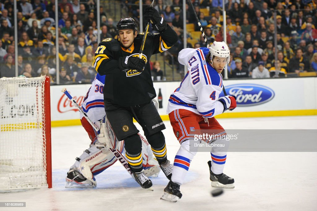 <a gi-track='captionPersonalityLinkClicked' href=/galleries/search?phrase=Milan+Lucic&family=editorial&specificpeople=537957 ng-click='$event.stopPropagation()'>Milan Lucic</a> #17 of the Boston Bruins watches the loose puck against <a gi-track='captionPersonalityLinkClicked' href=/galleries/search?phrase=Michael+Del+Zotto&family=editorial&specificpeople=4044191 ng-click='$event.stopPropagation()'>Michael Del Zotto</a> #4 of the New York Rangers at the TD Garden on February 12, 2013 in Boston, Massachusetts.