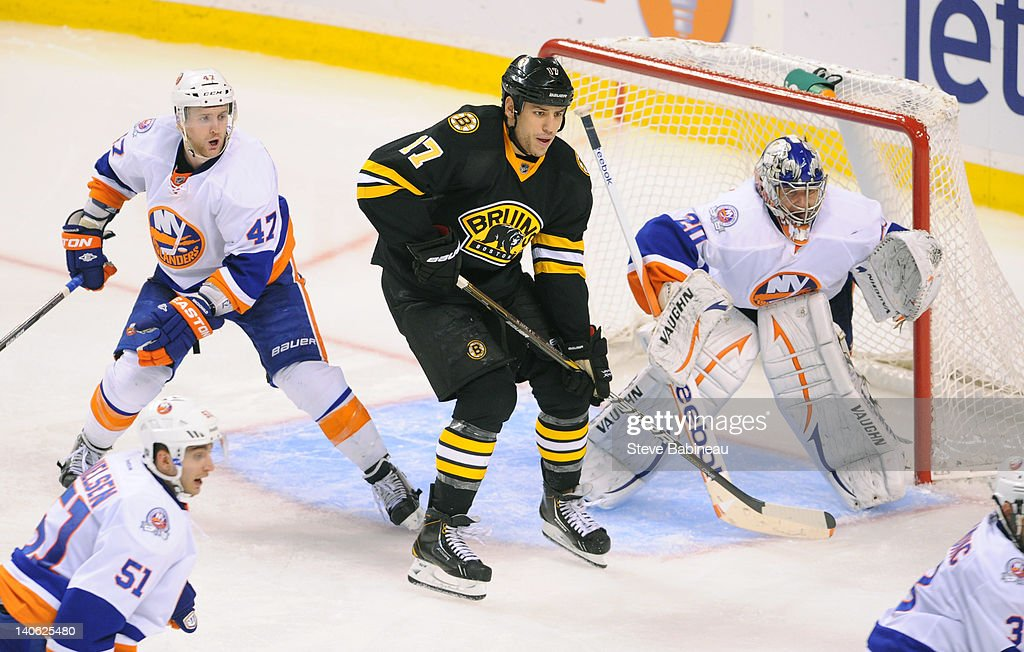 <a gi-track='captionPersonalityLinkClicked' href=/galleries/search?phrase=Milan+Lucic&family=editorial&specificpeople=537957 ng-click='$event.stopPropagation()'>Milan Lucic</a> #17 of the Boston Bruins watches the play against Andrew MacDonald #47 and <a gi-track='captionPersonalityLinkClicked' href=/galleries/search?phrase=Evgeni+Nabokov&family=editorial&specificpeople=171380 ng-click='$event.stopPropagation()'>Evgeni Nabokov</a> #20 of the New York Islanders at the TD Garden on March 3, 2012 in Boston, Massachusetts.