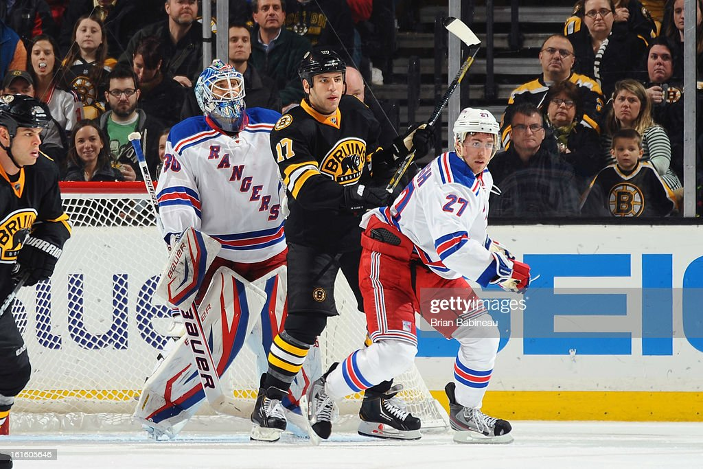 Milan Lucic #17 of the Boston Bruins watches the play against Henrik Lundqvist #30 and Ryan McDonagh #21 of the New York Rangers at the TD Garden on February 12, 2013 in Boston, Massachusetts.