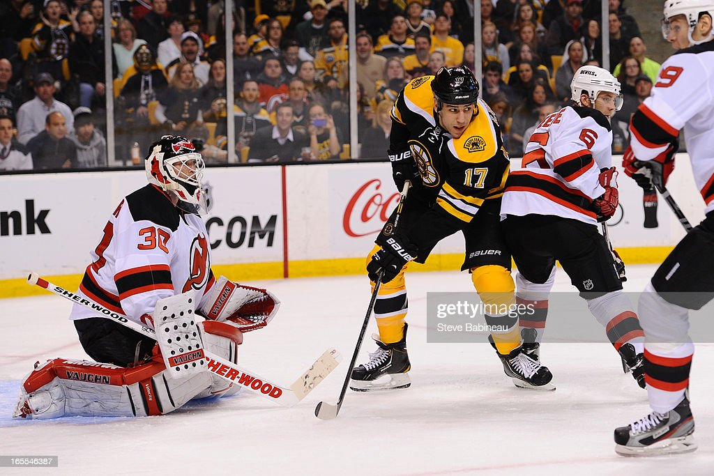 Milan Lucic #17 of the Boston Bruins watches the play against Martin Brodeur #30 and <a gi-track='captionPersonalityLinkClicked' href=/galleries/search?phrase=Andy+Greene&family=editorial&specificpeople=3568726 ng-click='$event.stopPropagation()'>Andy Greene</a> #6 of the New Jersey Devils at the TD Garden on April 4, 2013 in Boston, Massachusetts.