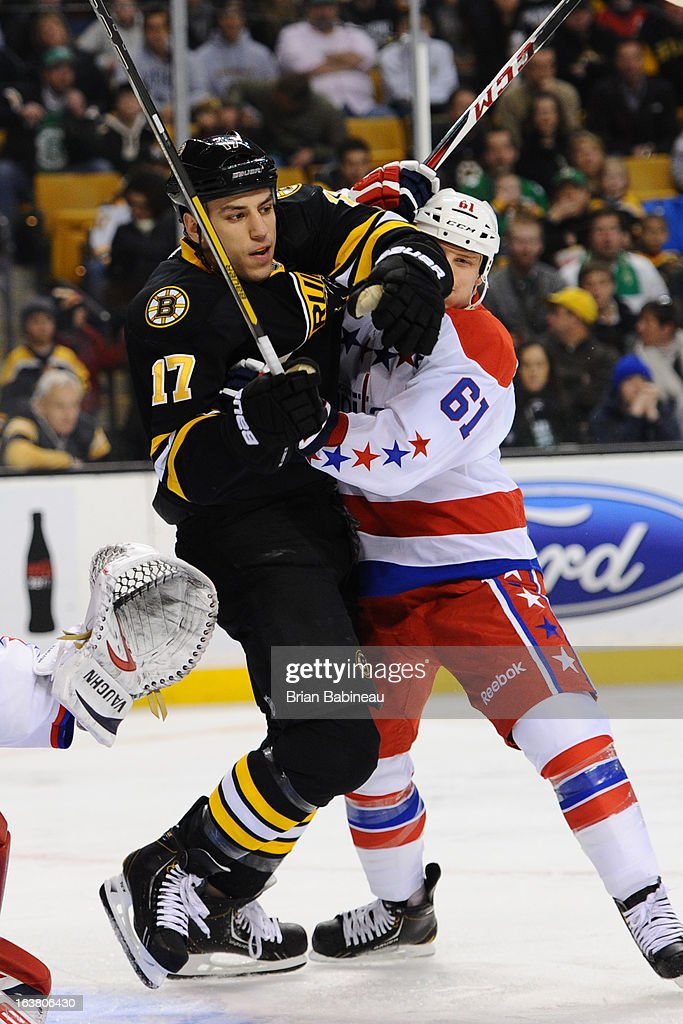 <a gi-track='captionPersonalityLinkClicked' href=/galleries/search?phrase=Milan+Lucic&family=editorial&specificpeople=537957 ng-click='$event.stopPropagation()'>Milan Lucic</a> #17 of the Boston Bruins watches the play against Steve Olesky #61 of the Washington Capitals at the TD Garden on March 16, 2013 in Boston, Massachusetts.