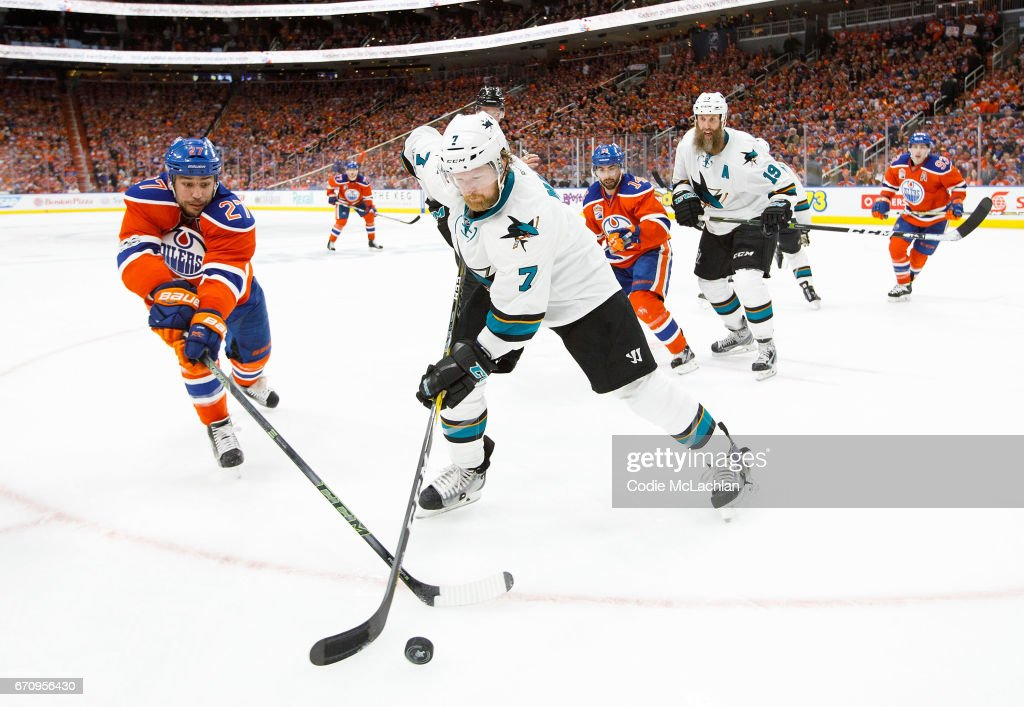 Milan Lucic #27 of the Edmonton Oilers battles against Paul Martin #7 of the San Jose Sharks in Game Five of the Western Conference First Round during the 2017 NHL Stanley Cup Playoffs at Rogers Place on April 20, 2017 in Edmonton, Alberta, Canada.