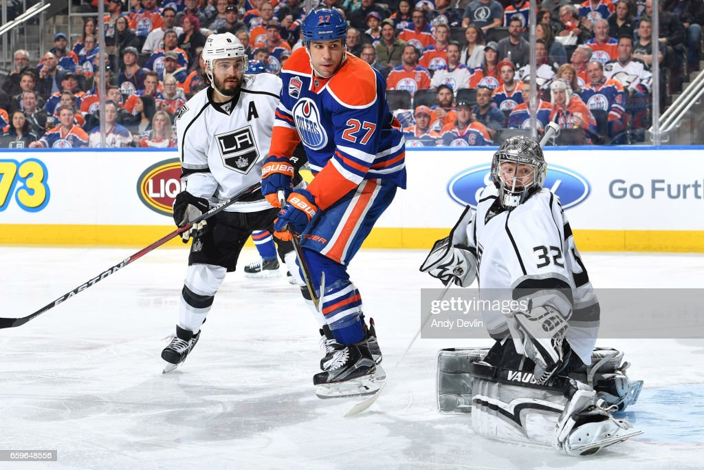 Milan Lucic #27 of the Edmonton Oilers battles for position with Drew Doughty #8 of the Los Angeles Kings on March 28, 2017 at Rogers Place in Edmonton, Alberta, Canada.