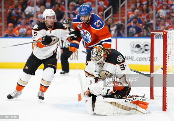 Milan Lucic of the Edmonton Oilers battles with Sami Vatanen and goalie John Gibson of the Anaheim Ducks makes a save in Game Three of the Western...