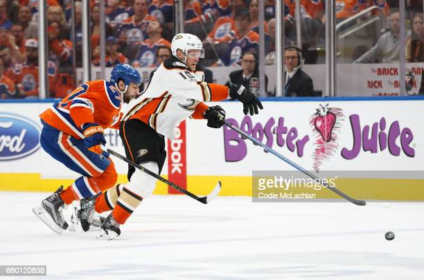 Milan Lucic of the Edmonton Oilers pursues Corey Perry of the Anaheim Ducks in Game Six of the Western Conference Second Round during the 2017 NHL...